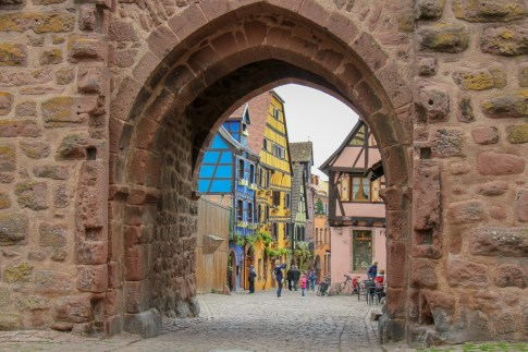 Entering Riquewihr Old Town through Thieves Tower in Riquewihr, France