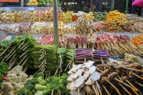 Ready-t-cook satay sticks at Jalan Alor Food Street stall in Kuala Lumpur, Malaysia