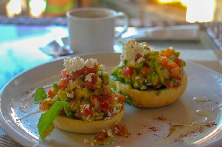 Avocado Salsa over poached eggs at Green Spot Cafe in Canggu, Bali, Indonesia