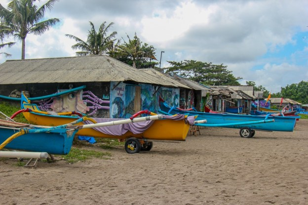 Traditional Balinese boats and boat houses in Canggu, Bali, Indonesia