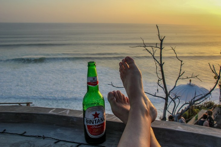 Bintang Beer and sunset views at Sunset Point in Uluwatu, Bali, Indonesia