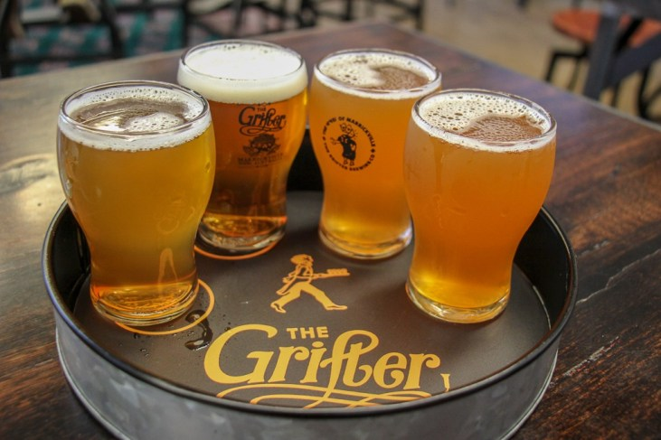 Tasters of beer at The Grifter Brewery in Marrickville, Sydney, Australia