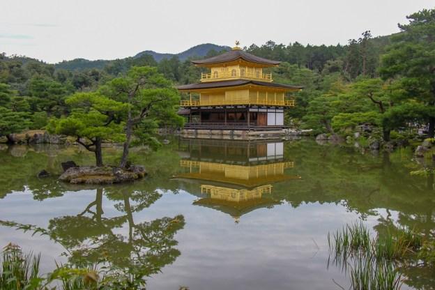 Kinkakuji Golden Temple reflecting on pond in Kyoto, Japan