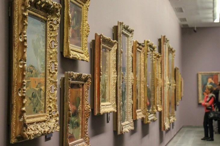Artwork in frames on wall inside L'Orangerie Museum in Paris, France