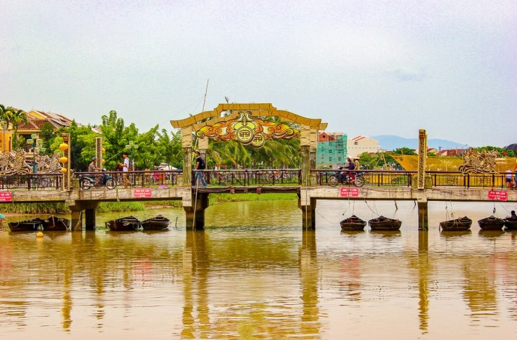 Bridge crosses Thu Bon River in Hoi An, Vietnam