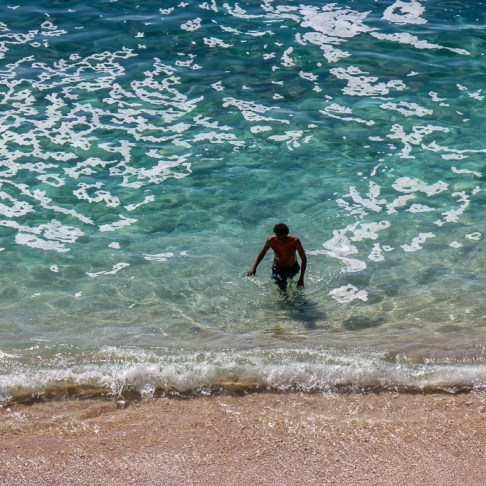 Man in water at St. Jacob's Beach in Dubrovnik, Croatia