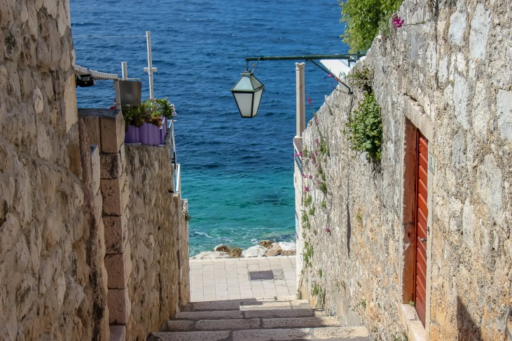 Stairs lead to water in Old Town Hvar, Croatia