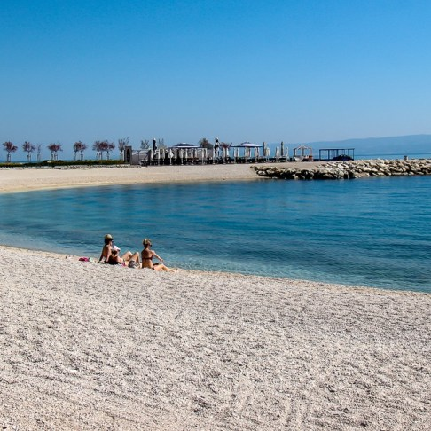 Two sunbathers at Radisson Beach in Split, Croatia