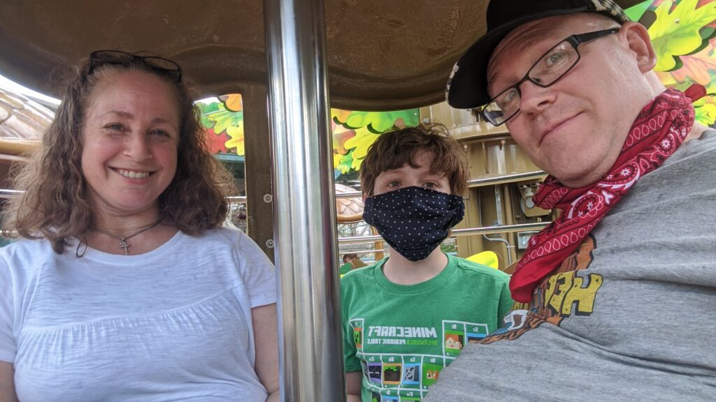 The Dandy Family squeezing into a flying acorn in Dollywood's Wildwood Grove