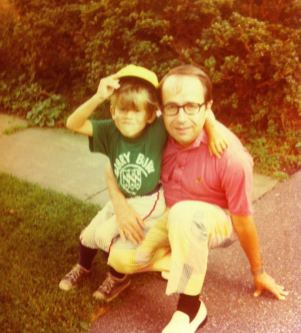 With dad on my first day of little league.