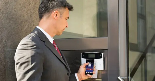 A businessman using a mobile phone for strong authentication.