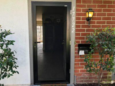 brick wall house single hinged security screen door