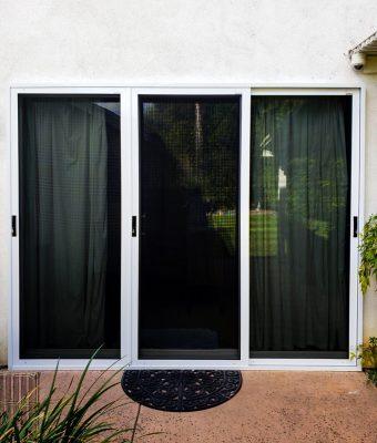 on site installation photo of sliding door security screen