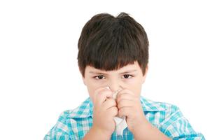 Human child cold flu illness tissue blowing nose