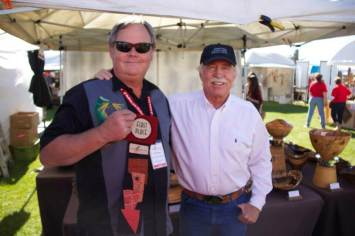Jeff Davison is presented with First Place in the Wood category by Sedona Mayor Rob Adams.