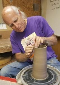 Luke Metz at the pottery wheel