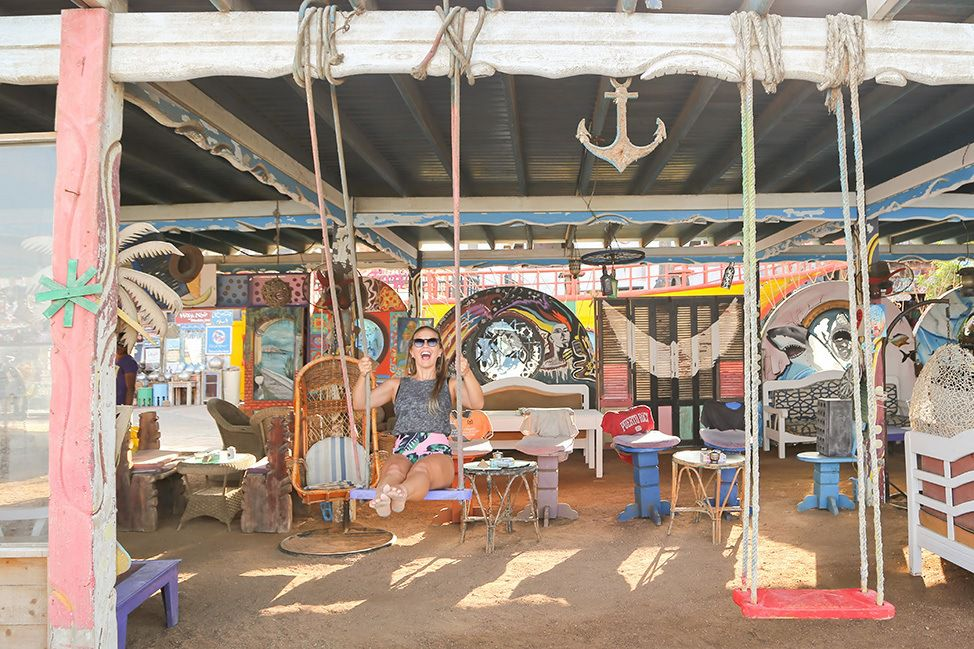 Tourist Enjoys A Cafe's Swing in Dahab