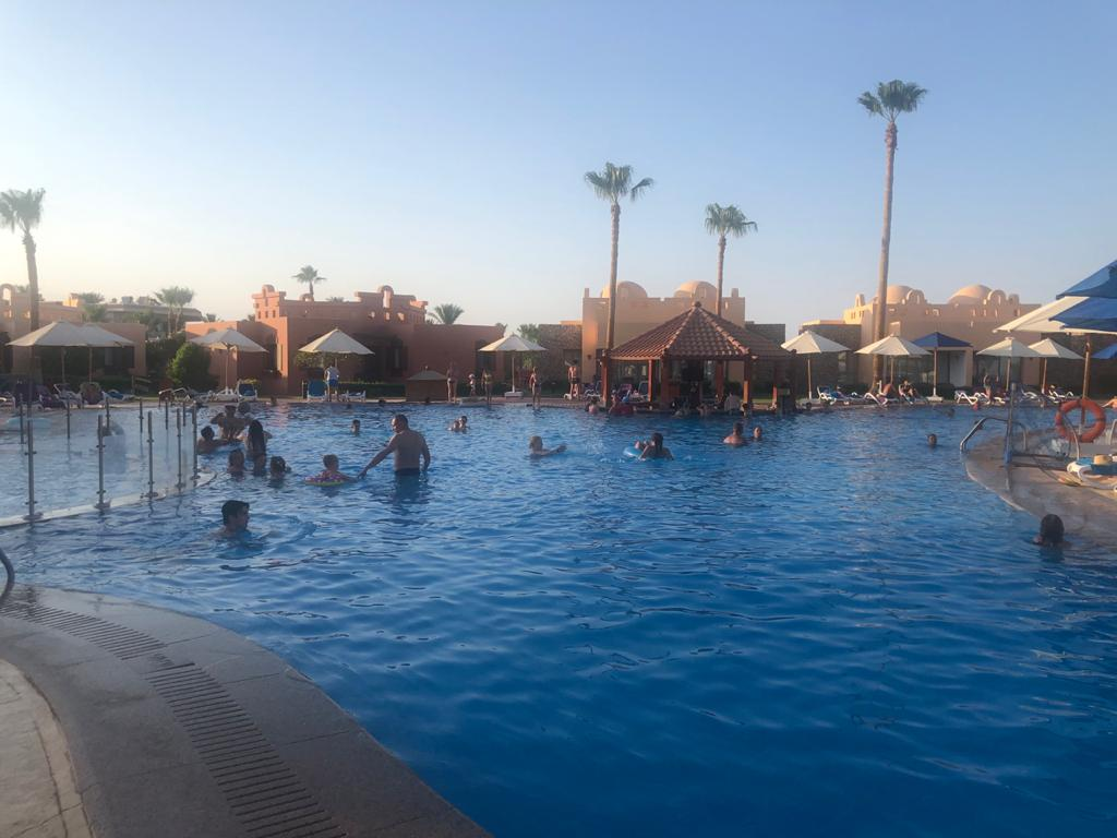 Tourists Enjoy Their Holiday at an Egyptian Hotel