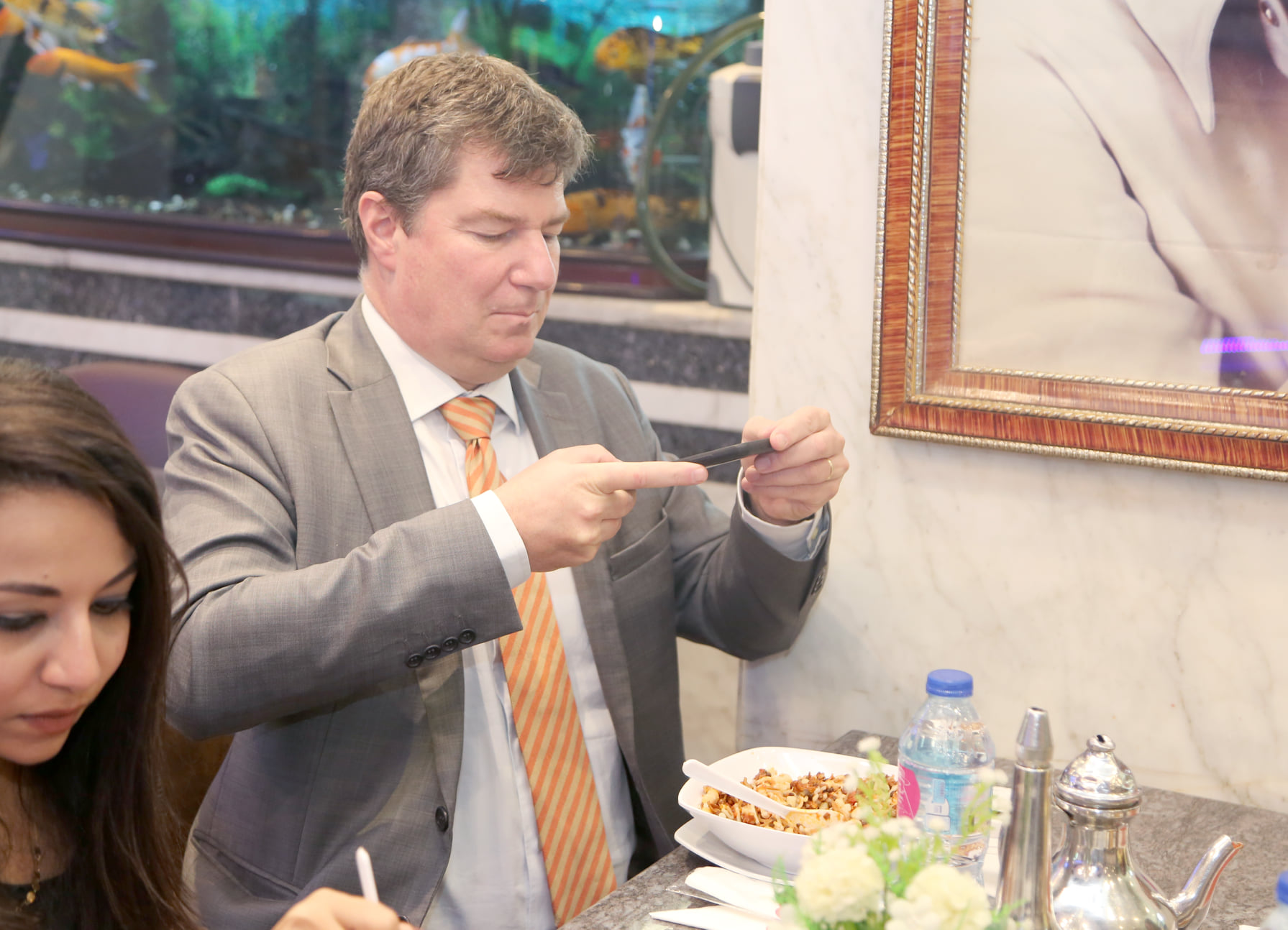 The ambassador takes a picture of the Koshary dish