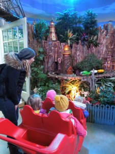Toddlers learning about holiday traditions at the U.S. Botanic Gardens.