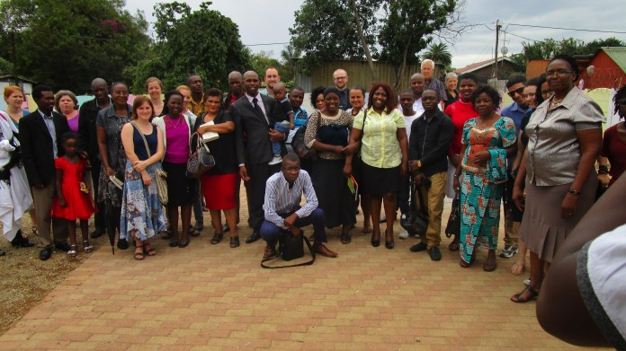 Seeders with members of a Brethren in Christ church in Johannesburg, South Africa