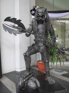 He is made completely of recycled car parts!