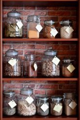 spice rack with glass jars of various forms and sizes