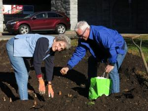 Scott Medbury, director of the Brooklyn Botanical Gardens plants with volunteer and my dear friend Toni Kelly.