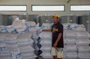 Staff member at Corluli seed warehouse in Maliana.