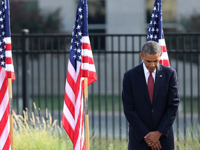 US President Obama bows head during prayer at remembrance ceremonies for 9/11 victims at the Pentagon 9/11 Memorial in Washington