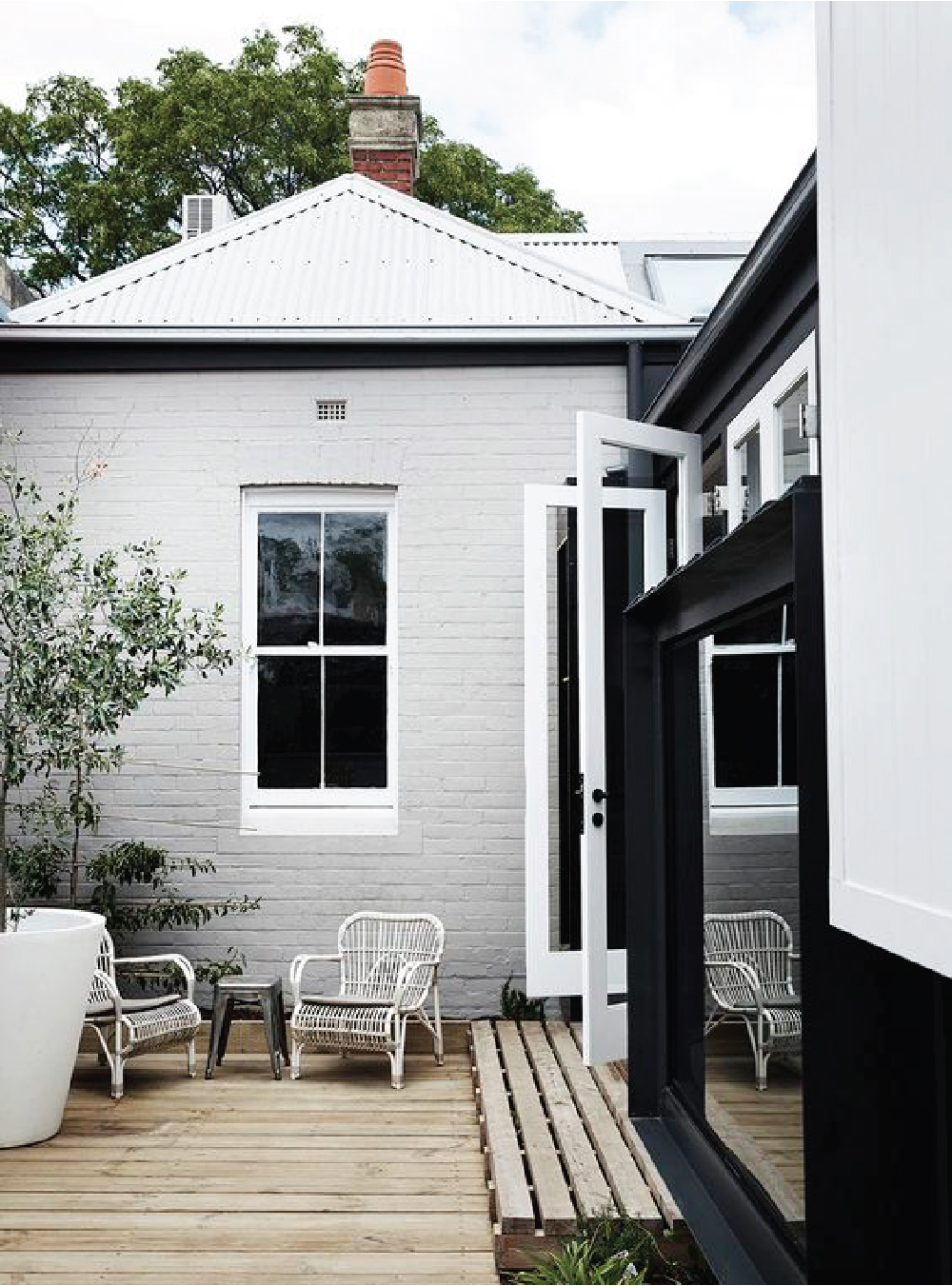 Modern, traditional houses with black door frames, white window trim, and gray walls and roof. Yum.