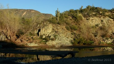 Agua Fria River with hillside and reflection