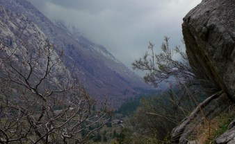Cliff-side with low clouds in Little Cottonwood Canyon