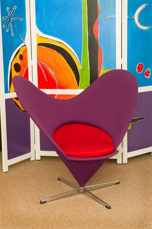 Verner Panton heart chair 1958, $5,200; Abstract art divider by Steve Tappas, $1,600.