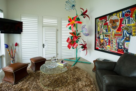 Much of the Smith's artwork, including the large abstract image (far right), was purchased at Danielle Peleg Gallery in West Bloomfield. The large flower piece (far right) was discovered at a Henry Ford art fair.