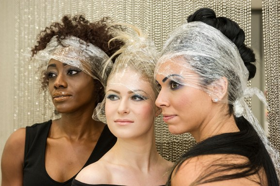 Dominique Jackson of Grand Blanc, Jenna Antonazzo of Troy and Tania Caringi of Sterling Heights show off their Cadillac-insipred makeup, courtesy of Luigi Bruni Salon.