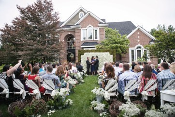 McKnight and Dunn exchanged vows in front of an 8- by 10-foot structure festooned with hydrangea and baby's breath, constructed by Emerald City Designs in about 20 minutes. Reverend Kathleen Reid officiated.