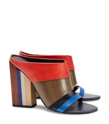 Tory Burch MIKA MULE ($395) in Masai Red/Natural Wood/Neptune, at Tory Burch, Somerset Collection, Troy (248-458-1307; toryburch.com).