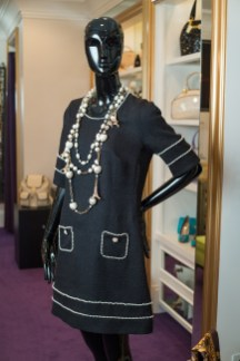 Audrey Hepburn-inspired black A-line with white stitching, $835, with pearl and gold Eiffel Tower necklace, $347, by a Parisian designer.