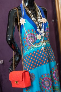 Vibrant summer maxi from Spain $130, Italian leather handbag, $165; flower layered necklace from Paris, $257.