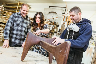 Owners Dan Laund-roche, Loren Weiner and Brian Laundroche look at an Adrian Pearsall coffee table base.