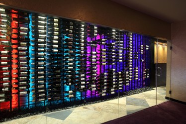 "Contemporary ""floating"" wine cellar design with LED lighting."