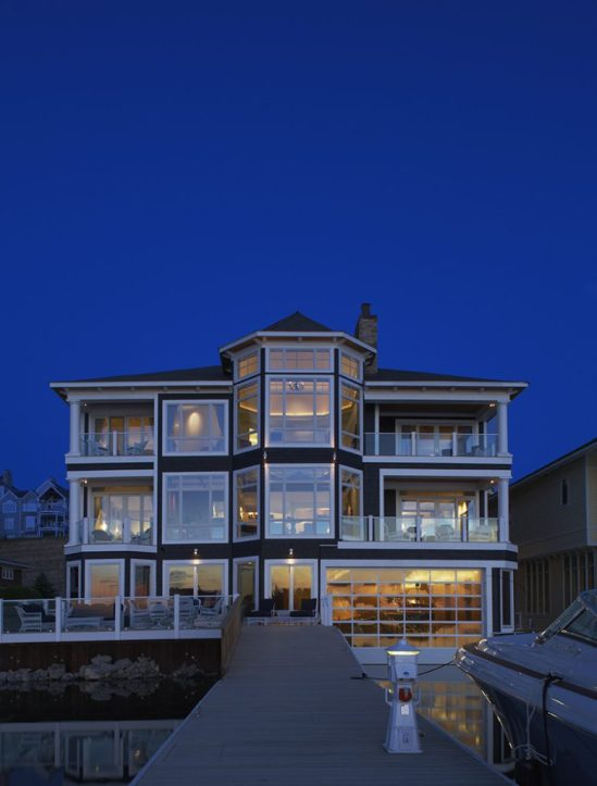 One of the original homes in Bay Harbor, this Cape Cod was modernized so every room has an extraordinary lake view. See the interior designs by Michael Coyne on the following pages.