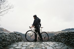 Cyclist on the brow of a bridge