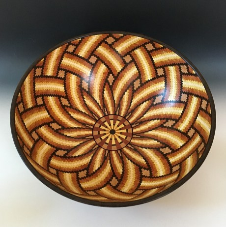 """14.25"""" x 5.125"""". Made with Cherry, Wenge, Bloodwood, Yellowheart, Holly and Chakte Viga. There are 144 pieces per row for a total of 6,145 pieces. Not everyone will see the 3D effect, but I hope you do."""