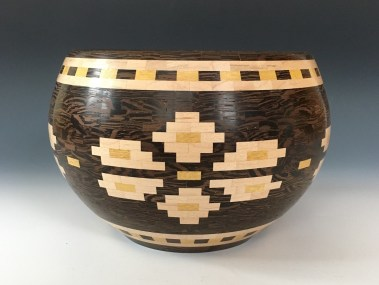 4.75″ high x 7″ wide. Made with Wenge, Maple and Yellowheart. This bowl has 1,226 pieces total