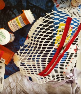 A zoomed-in portion of a mixed media art project Lindsey created, featuring the face mask she wore during radiation