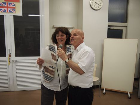 Mel and Dennis leading the singing