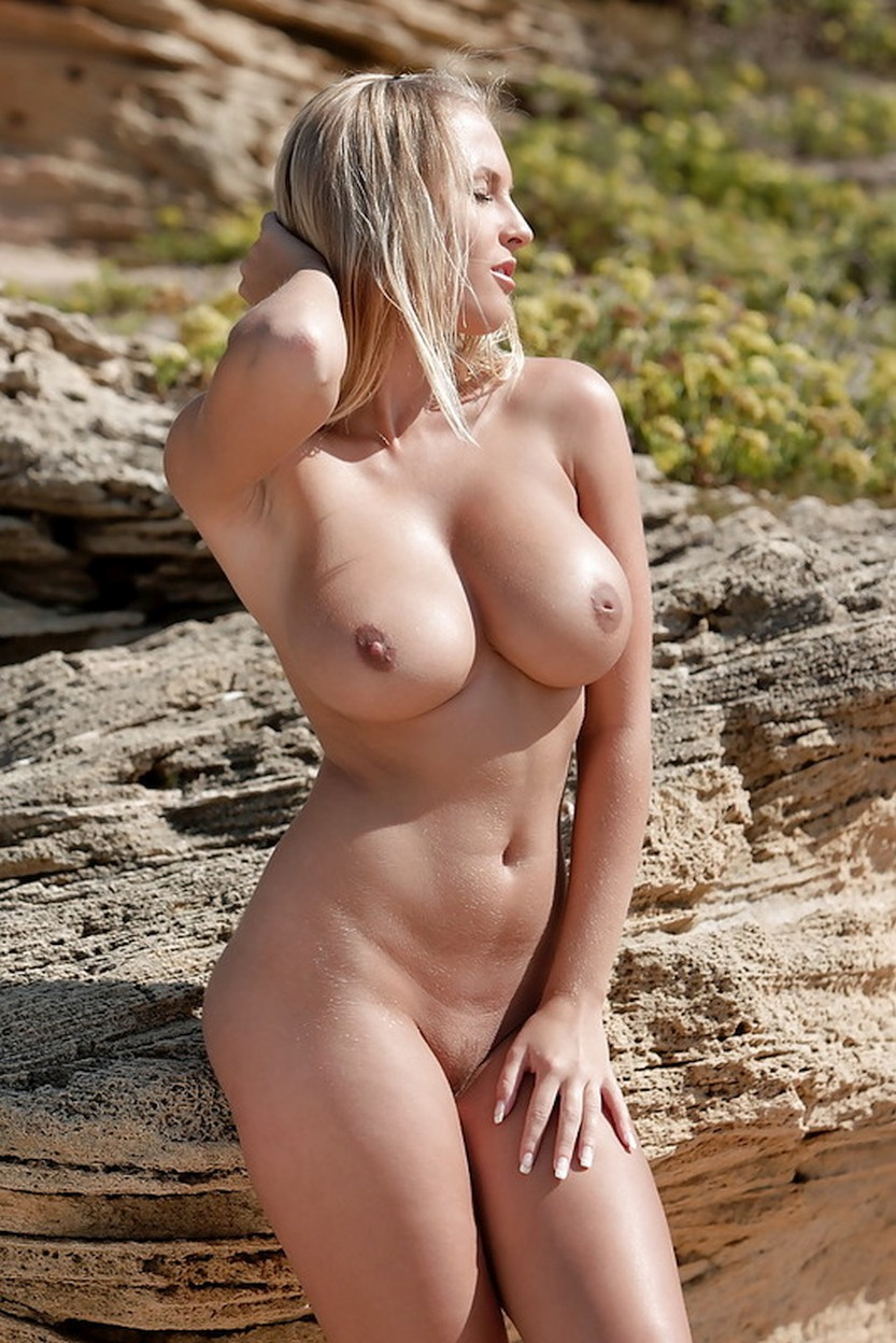 busty-pornstar-spreading-her-legs-in-the-sand-03