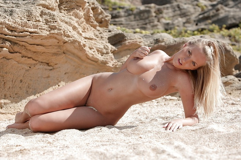 busty-pornstar-spreading-her-legs-in-the-sand-08